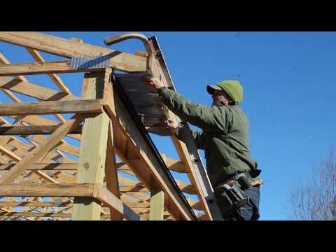 Installing the soffits on the pole barn