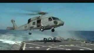 Helicopter landing on deck of USS John S. McCain