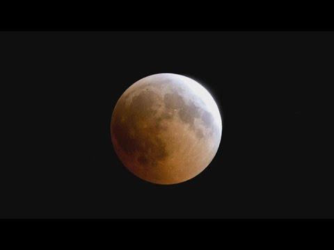 "Century's longest ""blood moon"" eclipse captivates the world"