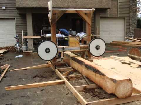 Cutting A Pine Board Using A Homemade Wood Bandsaw Mill Youtube