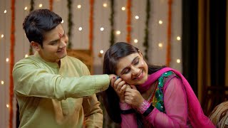 Indian sister tying rakhi on her brother's wrist and expressing the love - Raksha Bandhan