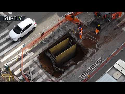 RAW: Massive 5-meter crater opens in Rome city center