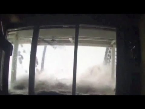 Family watches storm hit home via surveillance video