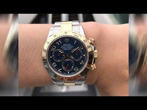 Rolex Cosmograph Daytona 116523 Blue dial 40 mm two tone steel and yellow gold luxury watch on wrist