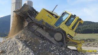caterpillar d6n dozer pushing gravel