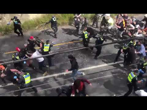 Lockdown protesters in Melbourne, Australia break through a police line and chaos ensues
