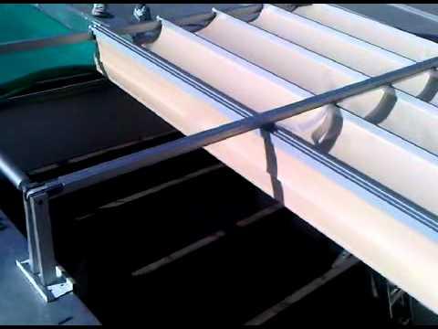 Toldo plegado una corredera sobre pergola 3gp youtube for Carriles de aluminio para toldos