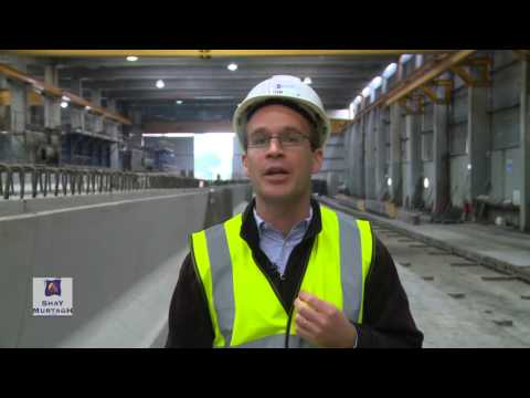 Q2. What are the benefits of using high strength concrete in prestressed beams?