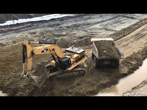 Caterpillar 390D Excavator Loading Cat Dumpers