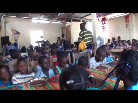 Haiti: Children praying before their daily meal.