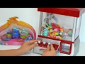 BananaKids Playing Game Claw Machine Candy Grabber Trolls Shopkins and Surprises Girls Vs Boys!!!