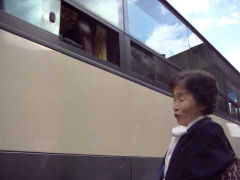S. Korean woman sings doleful Korean folk song to her N. Korean brother during family reunions