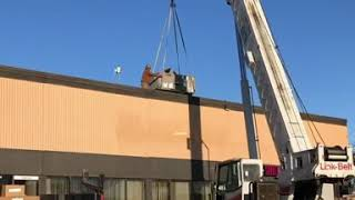 Crane removing rooftop units for DHR