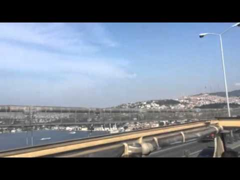 Crossing from Europe to Asia in Istanbul , Turkey on the Bosphorus Bridge in an open top bus!