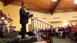 Gary Lewis leading congregation singing-O What Singing