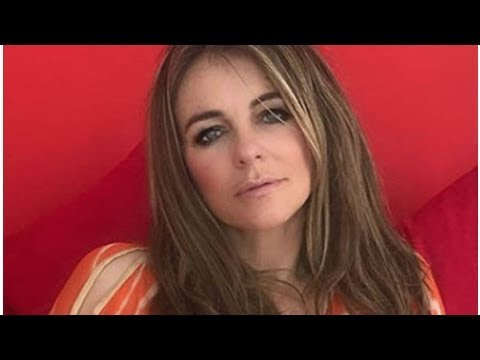Liz Hurley, 52, flashes EVERYTHING as she banishes bra in see-through kaftan thumbnail