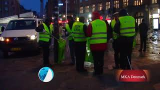 Danish Ahmadi Muslims clean the streets on New Years Day