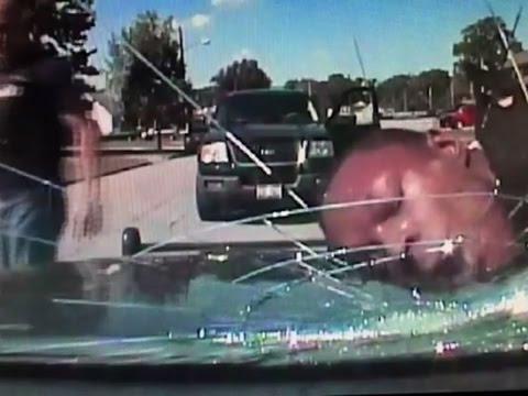 Ohioan: Police slammed head, cracking windshield
