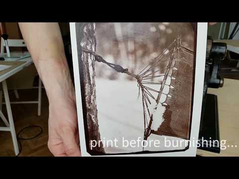 Burnishing albumen print from wet plate collodion negative.