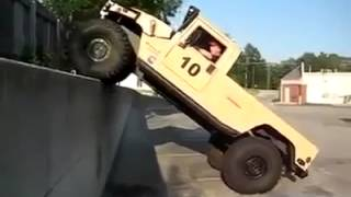Hummer climbs 6 foot wall