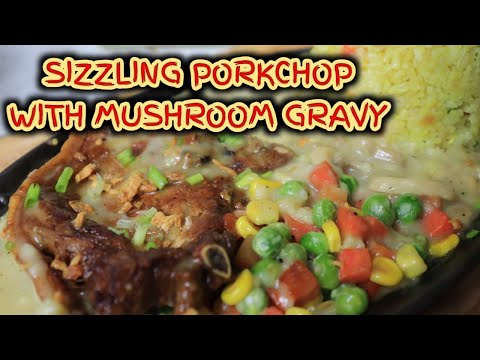 SIZZLING PORKCHOP   WITH MUSHROOM GRAVY