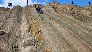 Sliding Down Incan ROCK SLIDES At Ruins || Cusco Peru