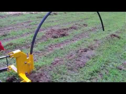 Implements Direct Single tine ripper with pipe laying attachment demo
