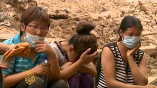 Search continues for China landslide survivors