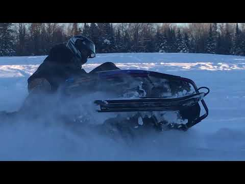 Snowmobiling Deep Snow In Northern Wisconsin
