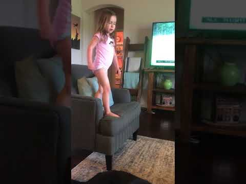 Avery jumping around the living room