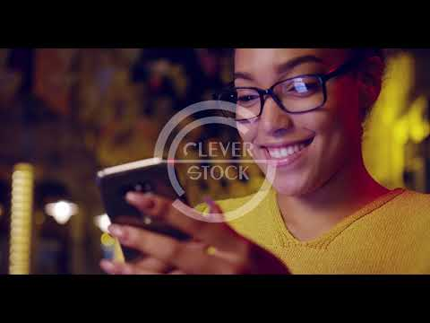 Beautiful African Woman Browsing Smartphone Enjoying City Life Mobile Business Outdoors Slow Motion