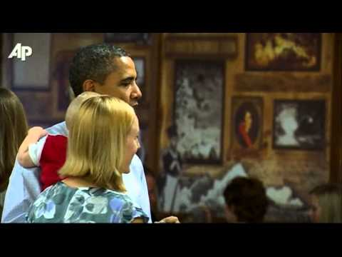 Raw Video: Baby Sticks Fingers in Obama's Mouth
