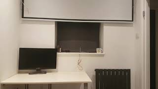 Projector screen with tv lift monitor drop