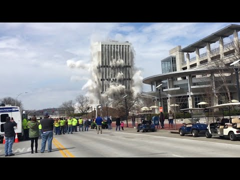 Crowds watch as tallest building in Kentucky's capital is demolished