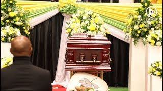 ProKid's family battle to contain their emotions at the hip hop star's funeral