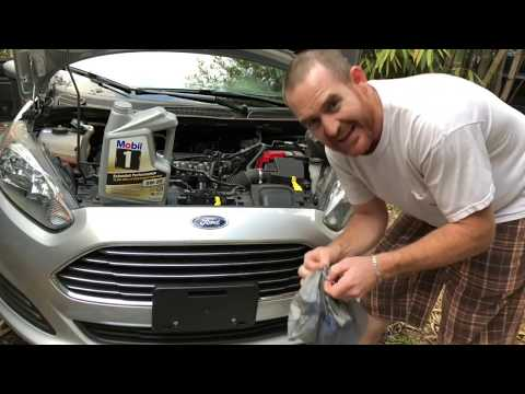 How to Change Your Engine Oil!!! Changing Dirty oil to Synthetic oil in Ford Fiesta Motor