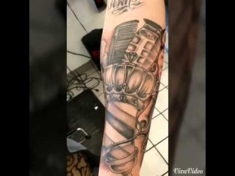 Barber half sleeve tattoo.