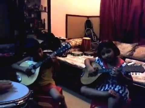 Ishani Matilal & Rudraneel Matilal playing JIngle Bells in Mandolin