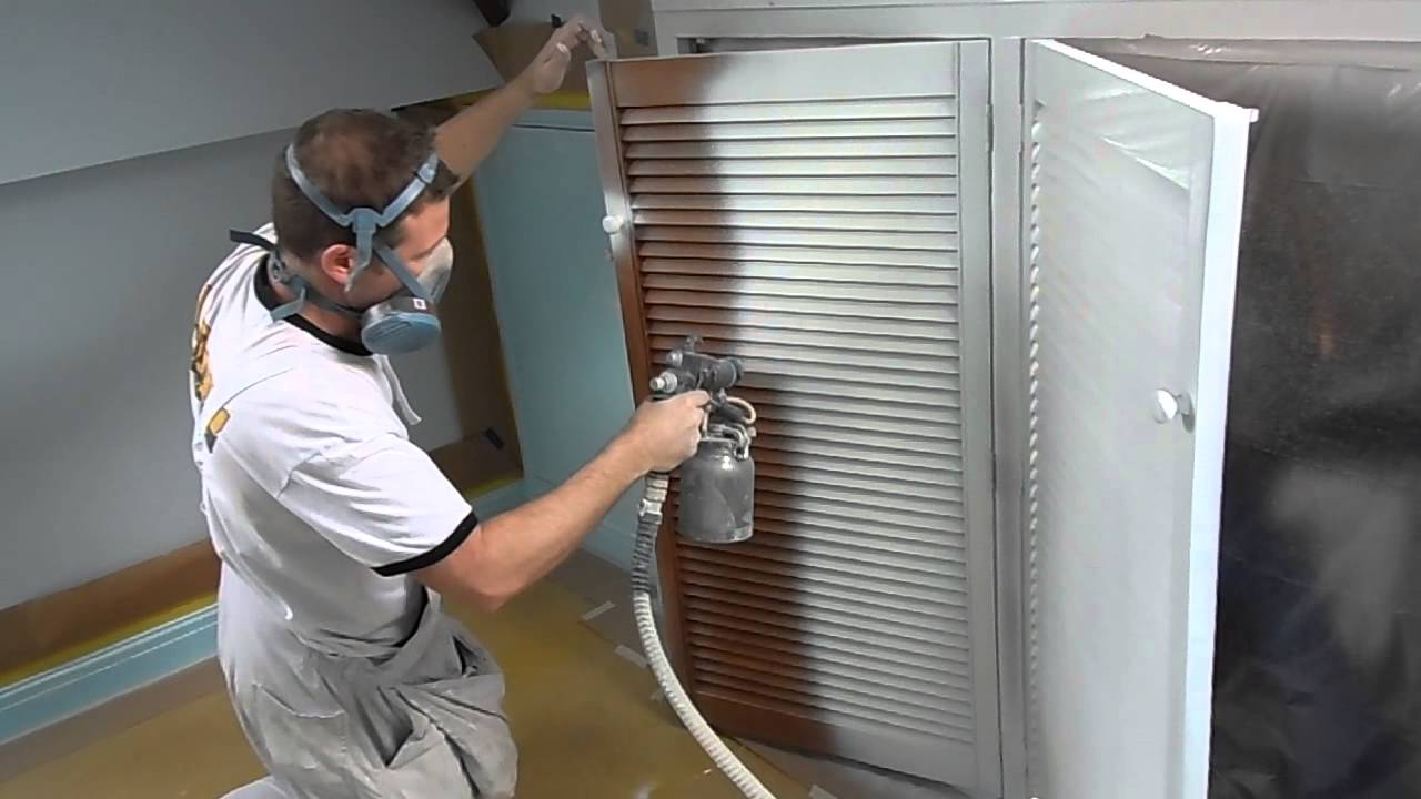 HVLP Spraying Sikkens BL Primer on louvre doors with a