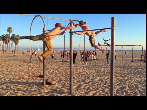 Ninja Warriors Swing on High Bar at Beach
