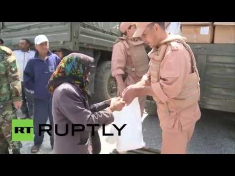 Syria: Russian military distribute around six tons of aid near Turkish border