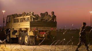 Soldiers put up fences along US-Mexico border to deter migrant caravan