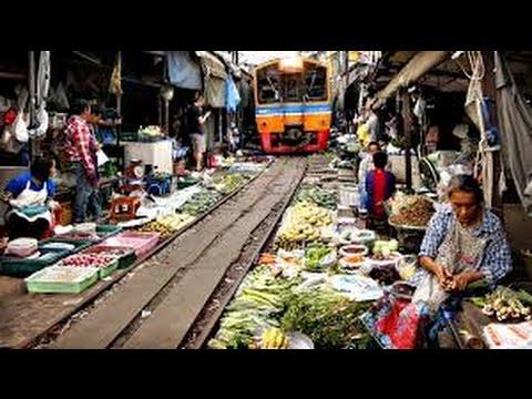 Maeklong Railway Market - Thailand's most dangerous wet market