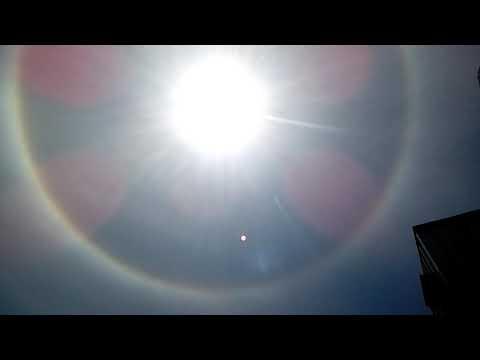 Aureola que tiene el sol en este momento en Santiago de chile