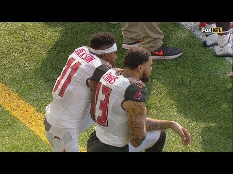 Two Buccaneers players kneel during national anthem