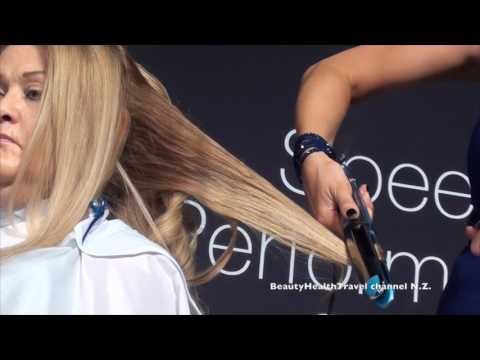 Curling the hair with a flat iron at I. S. S. E.