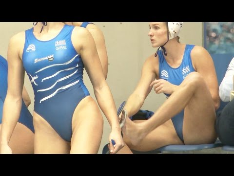 a gorgeous female waterpolo player Greek bench