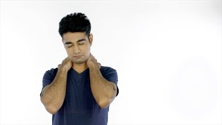 Attractive young guy suffering from severe neck pain - health and medical concept