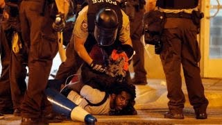 Third night of violence rocks St  Louis