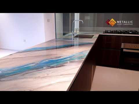 Metallic Epoxy Coated Countertop (Light Blue, Turquoise and Black Highlights on Light Khaki Base)